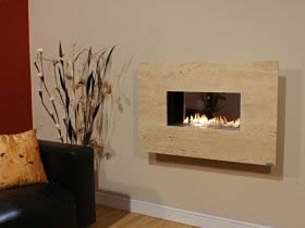 Flueless gas fire with travertine fascia.
