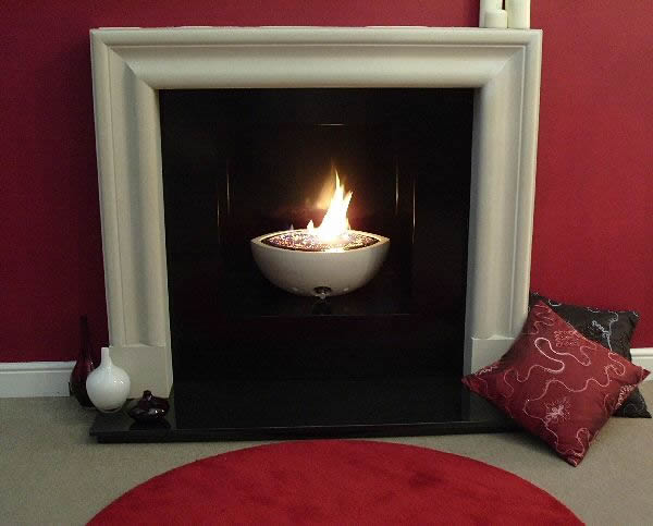 anubis suite - traditional hole in the wall fireplace with cast stone firebowl