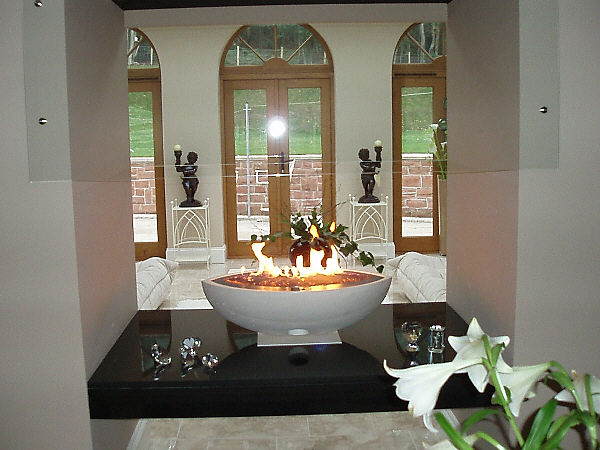 Large Oval Gas Fire Bowl in floating double sided enclosure.