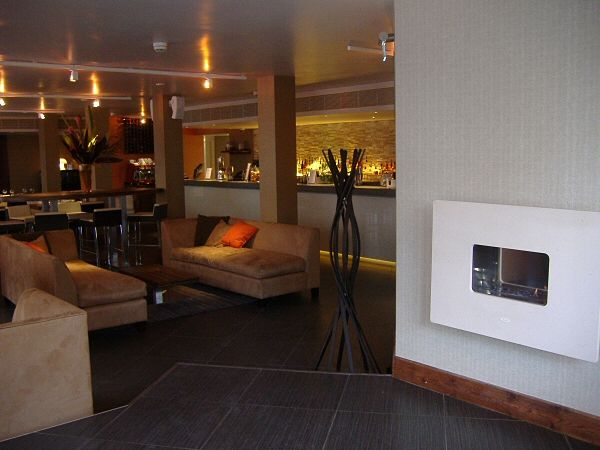 Hang on the wall flueless gas fire with open flame