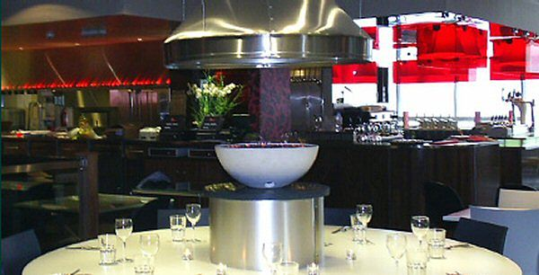 white circular gas firbowl with steel canopy