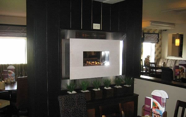 recessed flueless fireplace with 4 piece limestone fascia