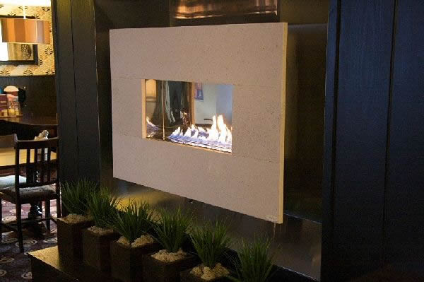 widescreen flueless open flamed limestone fireline recessed in wall
