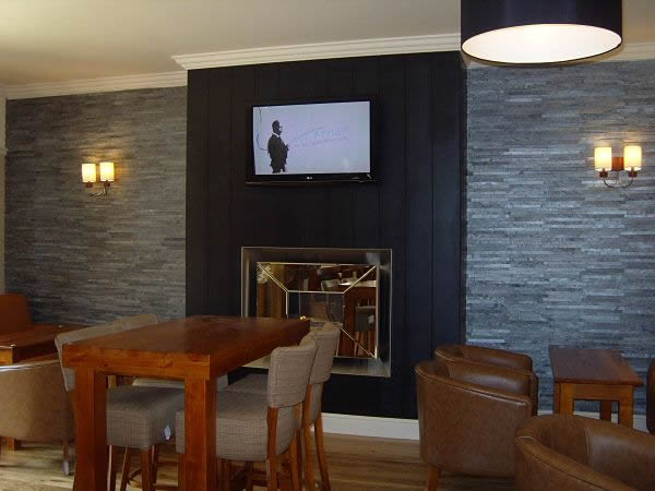 recessed flueless gas fire with mirrored fascia and open flame