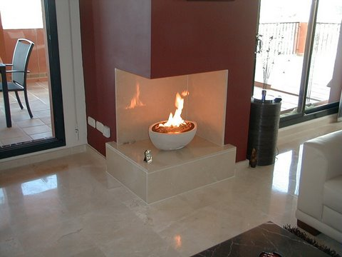 corner fireplace with large oval white cast stone fire bowl gas fire