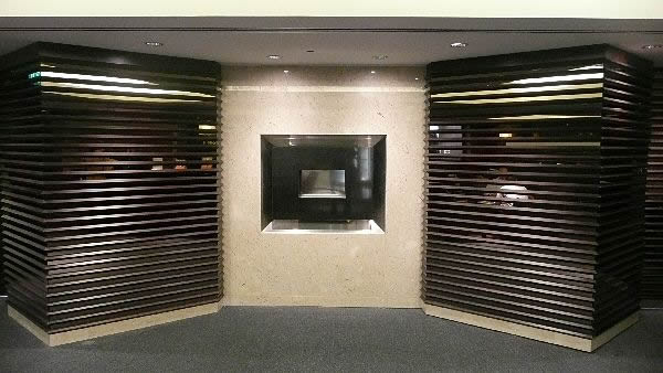 recessed flueless gas fireplace with black granite fascia