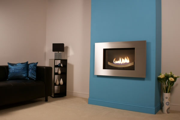 bonita traditioanl flueless fireplace with solid wood surround and cream stone fascia