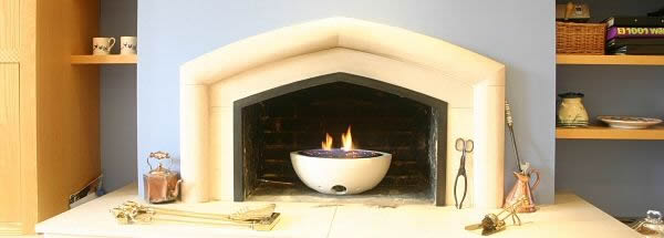 small oval white cast stone gas fire bowl