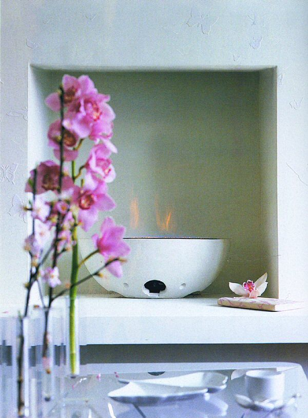 white cast stone firebowl hole in the wall setting
