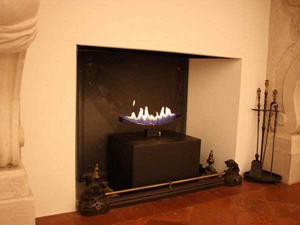 cast slit gas fireplace in traditional surround