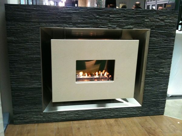 recesssed flueless fire with limestone fascia.