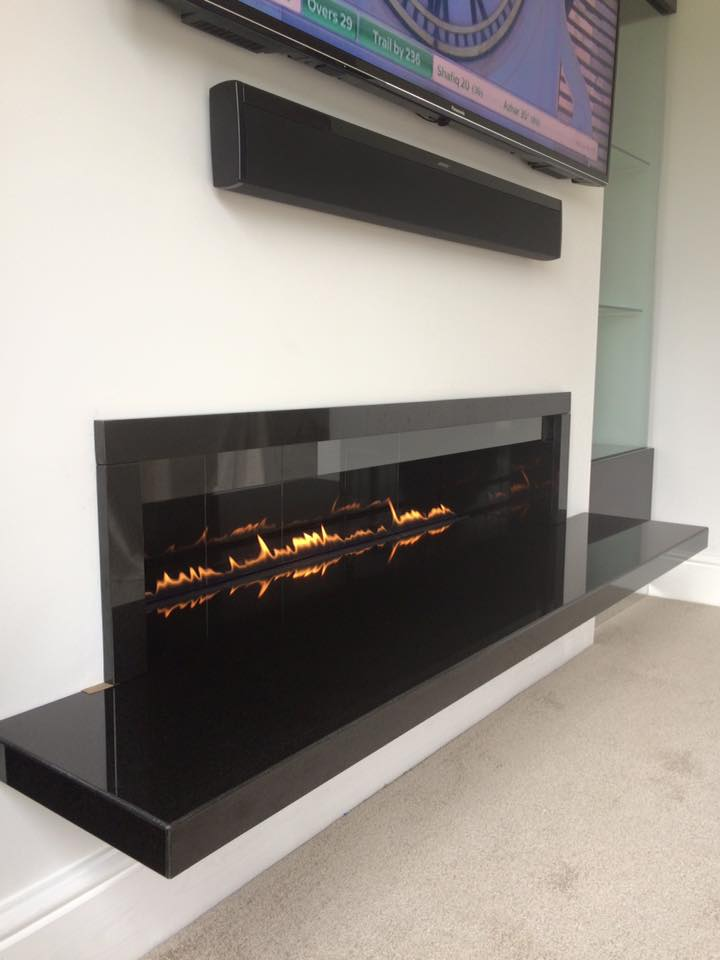 Black Granite Fire Break with TV above