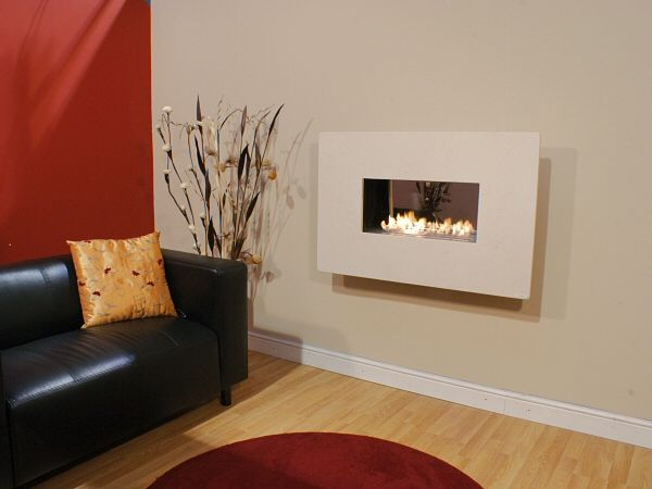 widescreen flueless fireline with 4 piece limestone fascia and highly polished interior