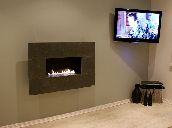 flueless wall mounted gas fire with green limestone fascia as installed in a customer home.