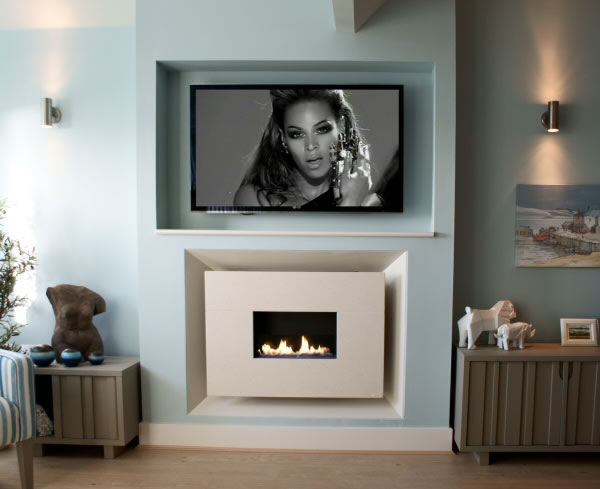 recessed flueless fireline with open front and flame and TV recessed in the wall above