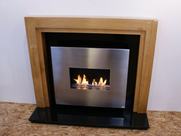 traditional flueless gas fire with oak surround and granite hearth