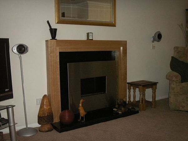 flueless fire with hearth in granite and surround in wood