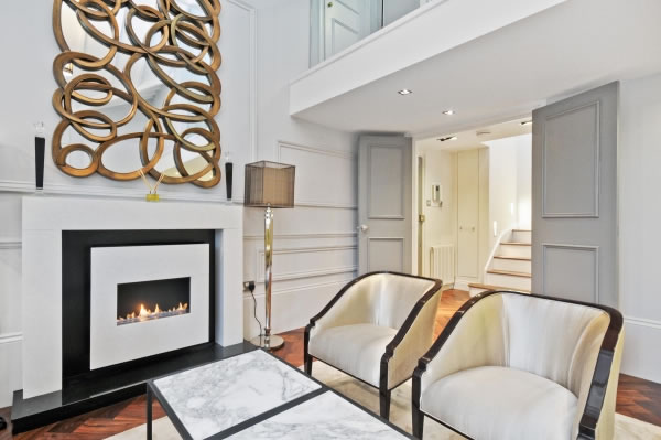 Read more about the article Traditional Flueless Gas Fire, White Stone Fireplace