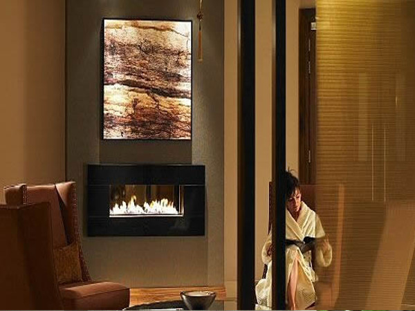 fire ribbon gas fireplace with portuguese limestone interior and fascia. also available in african black granite and other natural stone types.